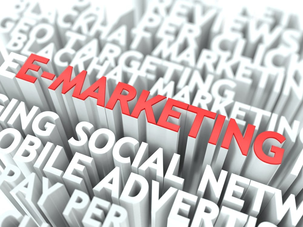 E-Marketing Concept. The Word of Red Color Located over Text of White Color.